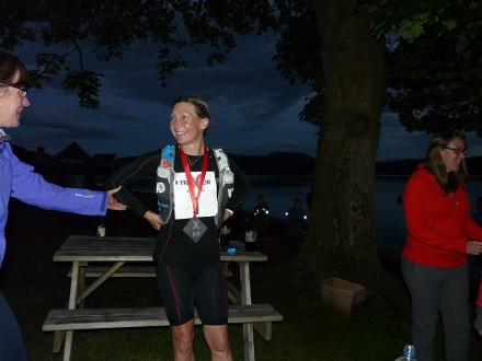 Getting the medal for taking part in Triathlon X. The hardest bike section of any Ironman in the world